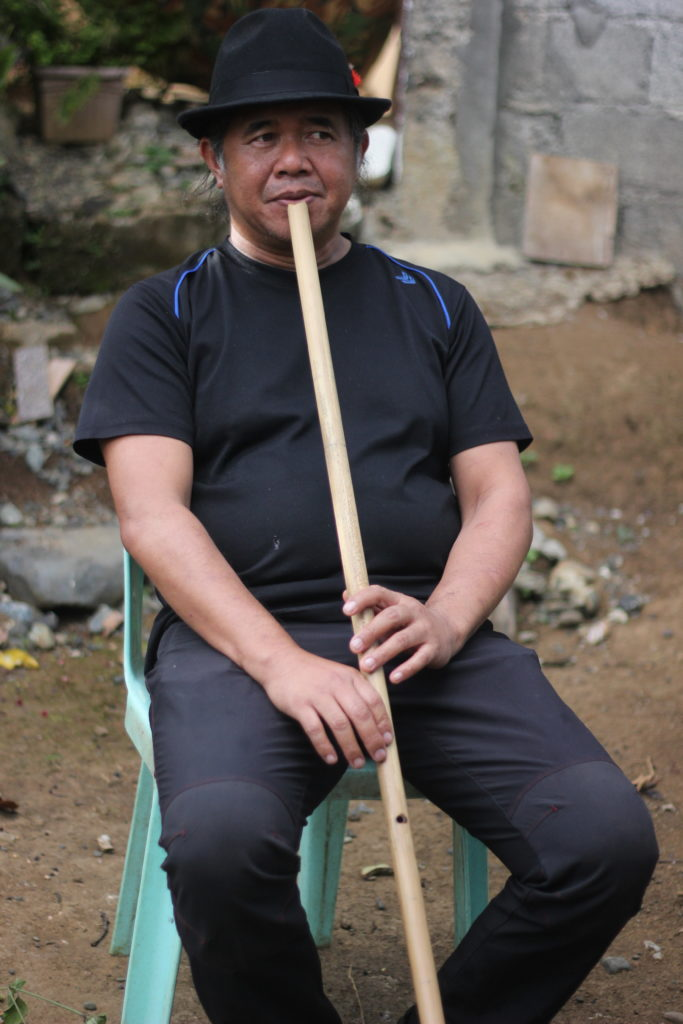 Tatay waway playing the musical instrument of the Talaandig in the Philippines