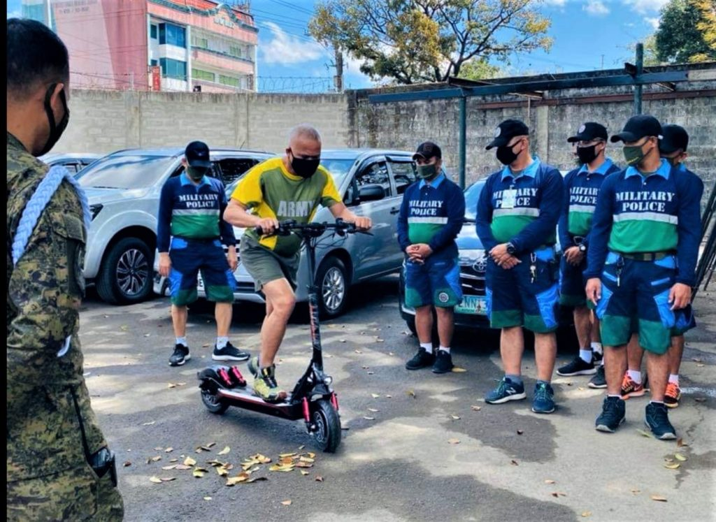 Members of the AFP try out electric kickscooters from Kaabo Scooters Philippines