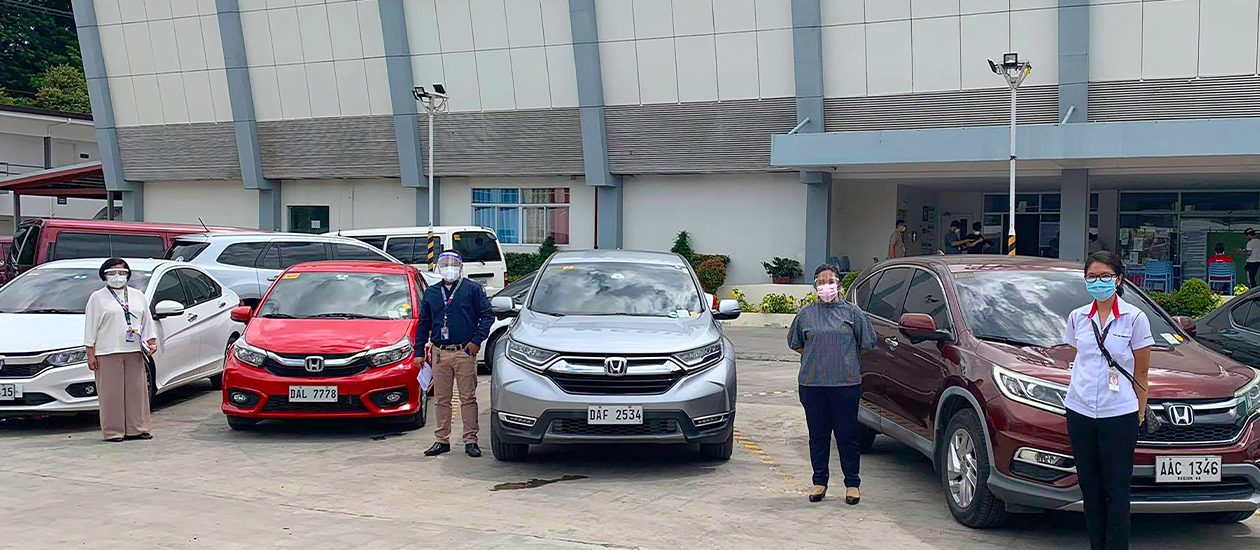Toyota representatives standing beside toyota vehicles